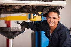 Oil change at an auto shop Royalty Free Stock Images