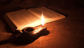 Oil lamp and Bible Royalty Free Stock Images