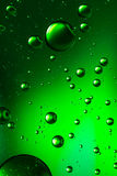 Oil and water, vivid green Stock Images