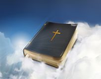 Old Bible book in the clouds Royalty Free Stock Photography