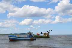 Old fishing boats against beautiful sky Stock Images