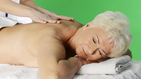 An old lady lying at spa salon. stock footage