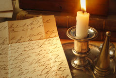 Old letters and candle, elegant handwriting Royalty Free Stock Photos