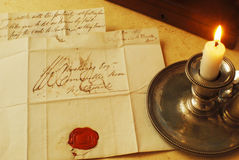Old letters and candle, elegant handwriting Royalty Free Stock Photography