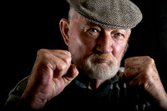 Old man fighting Stock Images