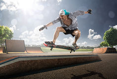 Old  Man skating in sunny day Royalty Free Stock Photos