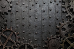 Old metal background with rusty gears and cogs Stock Photography