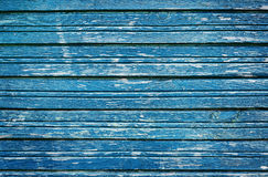 Old rustic wooden planks with blue cracked paint, vintage wall wood for background Stock Photo