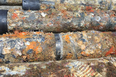 Old surface oilfield casing just pulled out of hole Stock Photos