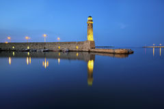 Old venetian lighthouse at harbor. Rethymno, Crete, Greece Royalty Free Stock Images