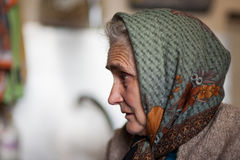 Old woman indoor Stock Photography
