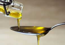 Olive oil over spoon Royalty Free Stock Photography