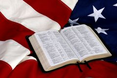 Open Bible on American Flag Royalty Free Stock Photography
