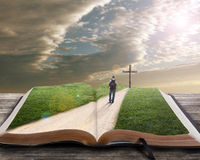 Open bible with man and cross Stock Photos