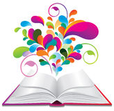 Open book with color splash. Stock Photos