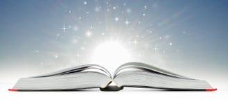 Open book emitting sparkling light Royalty Free Stock Photos