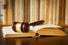 Open law book with a judges gavel Royalty Free Stock Photography