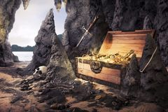 Open treasure chest with bright gold in a cave Stock Photo