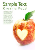 Organic apple with heart cutout Stock Images