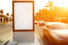 Outdoor advertising mock up, public information board on city road Royalty Free Stock Images