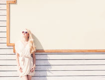 Outdoor summer sensual fashion portrait beautiful young blond woman of a white dress in sunglasses on the street on the background Stock Photos
