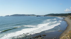 Pacific surf laps at the Oregon coastline. Stock Images