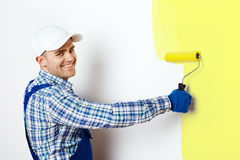 Painter painting a wall Royalty Free Stock Image