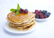 Pancakes with berries, honey and mint Stock Photography