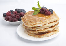 Pancakes with berries, honey and mint Royalty Free Stock Photo