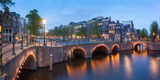 Panorama of beautifull Amsterdam canals with bridge, Holland Stock Photo