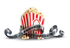 Paper bag with popcorn and movie reel Royalty Free Stock Photo