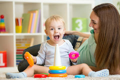 Parent and child boy playing together at home Royalty Free Stock Photography