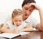 Parent with child writing Royalty Free Stock Photo