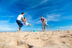 Parent Swinging Children at the Beach Stock Photos