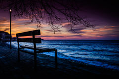 Park Bench On The Sunset Shore Stock Photo
