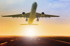 Passenger jet plane take off fron airport runway with beautiful Royalty Free Stock Image