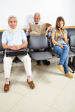 Patients waiting in waiting room Royalty Free Stock Images