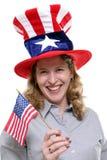 Patriottische Dame tegen Witte Achtergrond Stock Afbeeldingen
