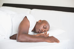 Peaceful man sleeping in bed Royalty Free Stock Photo
