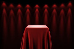 Pedestal with silk cloth and spot lights Royalty Free Stock Photo