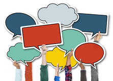 People Holding Colourful Speech Bubbles Royalty Free Stock Image
