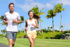 People running in city park - active lifestyle Royalty Free Stock Images