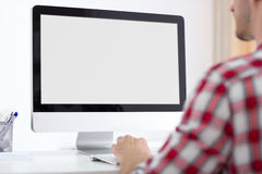 Person front of computer monitor Royalty Free Stock Photo
