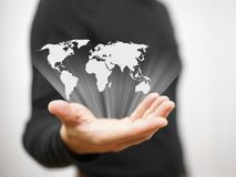 Person is showing world map Royalty Free Stock Image