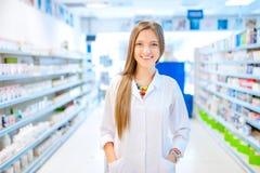 Pharmacist chemist woman standing in pharmacy Royalty Free Stock Photo