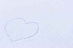 Photo de coeur sur la neige Photographie stock libre de droits