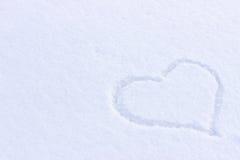 Photo de coeur sur la neige Images stock