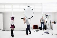 Photographer shooting fashion model in photo shoot Royalty Free Stock Photo