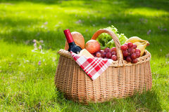 Picnic basket with food on green grass. Stock Photography