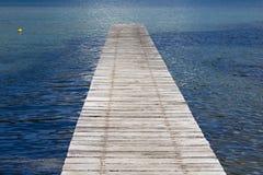 Pier into the calm sea Stock Photography